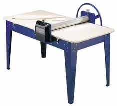 The North Star Super Slab Roller Packages are built for the hardest usage, this heavy-duty machine is intended for institutional and production settings and includes the Roller, 6 ft table, a Wagon Wheel handle and canvas. Slab Roller, Drafting Desk, Young Children, Rollers, Tabletop, Wings, Bucket, Note, Gym