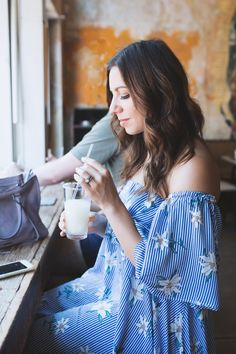 Lifestyle blogger Roxanne of Glass of Glam wearing a Shein floral off the shoulder dress