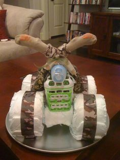 i was (and still am) quite proud of my 4-wheeler diaper cake! =)