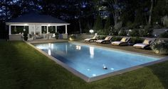 How to take your backyard entertaining from dull to dazzling with outdoor lighting. #outdoorlighting #poollighting