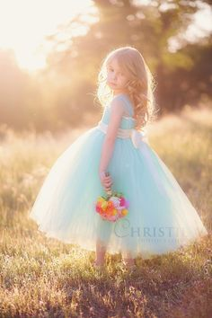 Our Seafoam tutu dress with Ivory Accents is definitely one of our new favorites!!! Created using a blend of mint green and aqua blue tulle, weve added ivory ribbon accents to create the sweetest contrast. Also featuring delicate tulle cap sleeves and a satin sash that can tie in a bow in the front or [...]