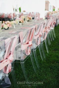Love the delicate pink satin on the ghost chairs! #ghostchair #miragechair #elegance #wedding...like the way it is tied