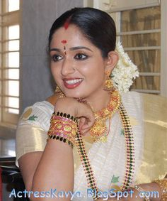 belly-actress-kavya-madhavan-soft-ass-photos-apocalypto