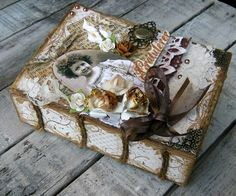 love the vintage style and the pretty embellishments (I think it's a box that looks like a book-not an actual altered book)
