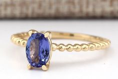 1.00CTW Natural Tanzanite Ring In 14k Yellow Gold by CignoJewels