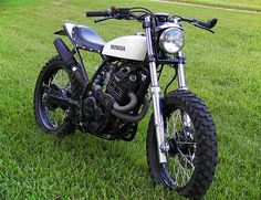 Honda's bulletproof enduro weapon for the latter part of the twentieth century was the XL600, a big four-valve thumper built to handle desert rallies. There were several variants and upgrades, and they weren't pretty bikes—but with a few modifications, the XL was surprisingly capable on the road. This street tracker conversion, however, sure is a…