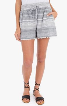 In a subtle striped pattern, these high-waisted linen shorts feature an elastic waistband, self-tie, side pockets, and a frayed hem. Linen Shorts, Striped Linen, Spring Summer 2018, Stitch Fix, Casual Shorts, Nordstrom, Tie, Clothes For Women, Pattern