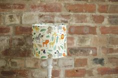 Jungle Lamp shade, Jungle nursery decor, Jungle animals, Jungle bedroom, Giraffe nursery, Monkey lamp, Animals lampshade, Boys nursery lamps by ShadowbrightLamps on Etsy https://www.etsy.com/uk/listing/558160827/jungle-lamp-shade-jungle-nursery-decor