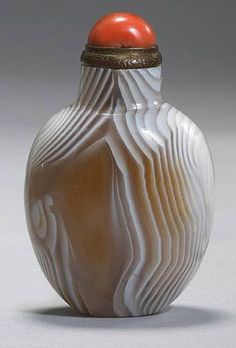 Property from the Estate of Gardner Hart Pierson. A banded agate snuff bottle. Of a compressed ovoid form, with a flat mouth rim and wide mouth, a flat oval base, the interior very well-hollowed, the body suffused with concentric white and brown markings suggesting a thumbprint formation; 2in (5.1cm) high. Estimate: US$1,500 - 2,500