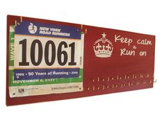 medals and bibs display - running medals and race bibs holder - like this one better. Would like to choose the quote.