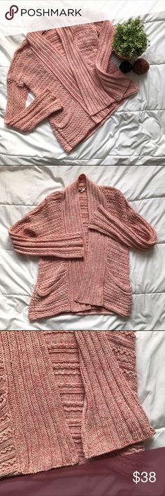 """Free People pink cable knit open front cardigan Excellent preloved condition. No flaws to note. Over dyed red and cream gives it almost a pink look. Ribbed and cable knit. 100% cotton. Chest is 17.5"""", length is 24"""" and sleeve length is 21"""". Free People Sweaters Cardigans"""