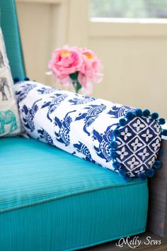 Outdoor sofa with bolster pillow - Sew a Bolster Pillow - Bolster Pillow Tutorial - Love this Boho Style pillow with pom pom trim! - Melly Sews