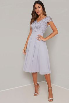 Silver blue with dress featuring a V shape neckline, cap shoulder sleeves, a fitted waistband leading to a layered chiffon midi skirt and finished with a centre back zip. Blue Midi Dress, Blue Dresses, Midi Skirt, Girls Dresses, Formal Dresses, Wrap Dresses, Embroidered Caps, Chi Chi, Fitted Bodice