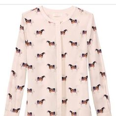 Tory burch tunic with horse print Horse print button down silk with some spandex for stretch Tory Burch Tops Tunics