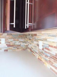 Tiled backsplash and the long silver handles that I'd love