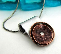 Mixed Metal Necklace - Hand Stamped Jewelry - Riveted Cold Connection with Copper Poppies - Rustic Metalwork Necklace (104). $23.00, via Etsy.