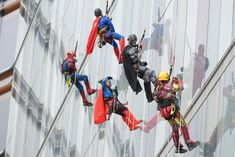 RHC patients marvel as superheroes descend building in charity abseil stunt