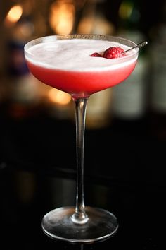 Clover Club Cocktail: 1 1/2 oz. gin 3/4 oz. fresh lemon juice 2 tsp. raspberry syrup 1 egg white Ice cubes Combine first four ingredients in a shaker and shake without ice for 10 seconds. Add ice and shake vigorously for at least 10 seconds. Strain into a chilled glass.