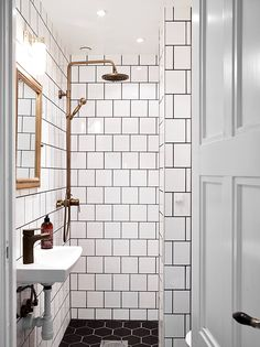 Yeah, I could live there. I have not, until this very moment, particularly liked or cared about dark grout. This white tiles/dark grout and black tiles/white grout look is AMAZING