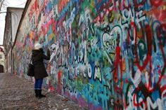 Lennon Wall - near the Charles Bridge.  After the assassination of John Lennon in 1980 this wall became a symbolic memorial to the lead singer of The Beatles and his songs of peace, freedom and love. As there was no freedom of speech in Czechoslovakia at that time people have been using the wall for expressing their feelings, writing peaceful statements and disagreements with communist regime. Many times the Lennon Wall was repainted by authorities but it was covered by graffiti again very…