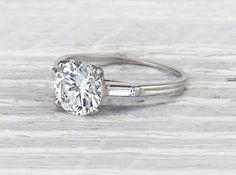 Retro Tiffany & Co engagement ring made in palladium and centered with a GIA certified 1.83 carat transitional cut diamond with F color and VS1 clarity. Signed Tiffany & Co. circa 1945. This classic T