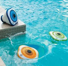 Waterproof speakers for your pool! These beasts light up with LEDs so you can keep the pool party going all night long. Each speaker is connected wirelessly to the transmitter, which connects to any iPhone, iPod or other music device with a standard 3.5mm audio jack. The transmitter and speakers are all battery powered and work just as well on dry ground.
