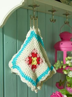 True & Sania <<--my new favorite  Gorgeous potholder with tiny granny square in the middle *love*