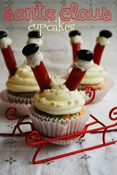 Santa Claus Cupcakes (legs:strawberry licorice, boots: black jellybeans or M)