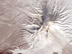 The Shiveluch volcano in Kamchatka, Russia, smolderingly visible from space. Image credit: NASA Earth Observatory/Jesse Allen/Robert Simmon, using data from the NASA/GSFC/METI/ERSDAC/JAROS, and U.S./JapanASTER Science Team.