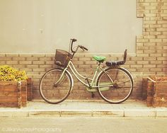 TITLE: Green Bicycle LOCATION: Beijing, China This photograph is part of a series of my Beijing Bicycle Project series, featuring bicycles that I found around the city of Beijing. This lovely bike was