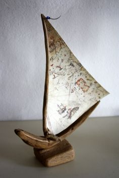 Make a sailboat using an aged map as the sail