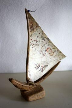 Make a sailboat using an aged map as the sail