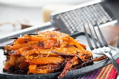 This side dish recipe for Garlic Roasted Carrots is so full of flavor that it's sure to a holiday favorite.