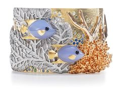 Tiffany & Co. Angelfish cuff with diamonds, blue chalcedony, spessartite, blue and green sapphires, and onyx set in 18-karat white, rose, and yellow gold.