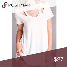 "White Cutout Neck Tee The cutout cold shoulder detail on the neckline is my favorite part about this shirt! Features: loose fit, v neck, short sleeves. This top is made with heavyweight knit jersey that is very soft, drapes beautifully and stretches very well. Rayon, Spandex. Made in the USA. Small Measurements: 18"" Bust, 26"" with 1"" between sizes Tops Tees - Short Sleeve"