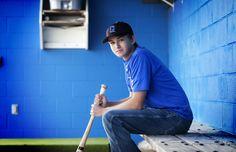 Baseball Portrait - simple again: cap, t-shirt, bat; in the dugout.
