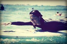 Robin Tunney surfing in Hawaii in July 2009.