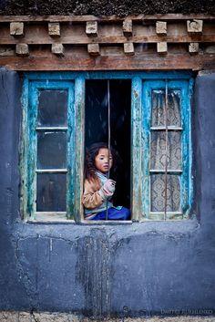 Girl in window - Girl in window. Village of Kibber, Spiti Valley, Himachal Pradesh