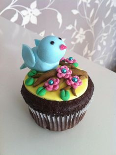 Fondant bird on a twig by Zilla's Cupcakes