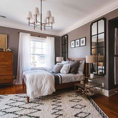 Putting a rug on an angle can really give a room a new dimension. This grey walled bedroom with mid century style bed is the perfect example.