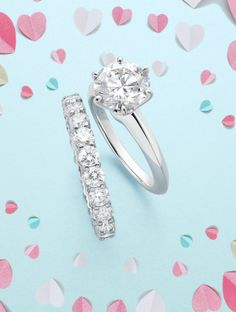 Let her try these on for sighs. The Tiffany® Setting engagement ring and shared-setting band ring in platinum with diamonds.