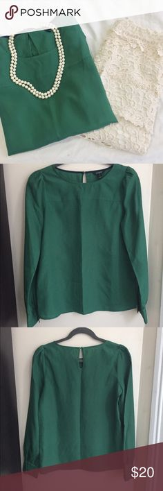 """J. Crew   Green Long Sleeve Blouse   Size: XS J. Crew   Green Long Sleeve Blouse   Size: XS   Great Condition   Fits Like a Small   No Wear   Missing Button For Cuff on Right Sleeve   Pet/Smoke Free Home   100% Polyester   Bust: 32"""" Length: 24"""" Waist: 32"""" J. Crew Tops Blouses"""