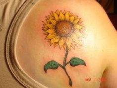 An adorable looking sunflower tattoo on the back. The minimalist design of the sunflower and depicting it as a single entity adds to the simplicity and the beauty of the overall design itself.