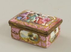 A Continental gilt metal mounted enamel box, late 18th/ early 19th century, of rectangular form, the hinged cover decorated with cartouche containing seated figures within a gilt Rococo style border, the body decorated with similar cartouches containing landscape, 8cm wide, (a/f).