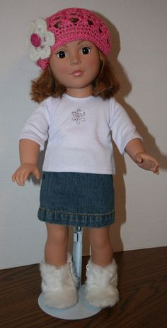 Samantha is wearing a jean skirt with elastic waist. She has on a white ¾ sleeve T-shirt adorned with a sparkly snowflake and a Velcro closure