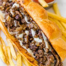 Philly Cheesesteak with tender ribeye steak, melted provolone, and caramelized onion in a garlic butter roll. Easy Philly Cheesesteak Sandwich video how-to. Philly Steak Sandwich, Steak Sandwich Recipes, Steak Recipes, Cooking Recipes, Philly Cheese Steak Sliders, Steak Cheese Sandwich, Sandwich Recipes, Barbecue, Pizza