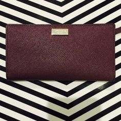 ♠️Kate Spade ♠️Stacy Billfold in Mulled Wine Brand new w/tag. Soft leather exterior. Button closure w/detailed pockets. 13 card pockets. kate spade Bags Wallets