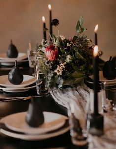 Break tradition by using chic dark and moody florals at your fall or winter wedding, like this elegantly dark floral centerpiece!