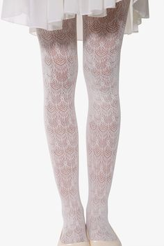 This item is shipped in 48 hours, included the weekends. These beautiful white tights are perfect for adding a child-like whimsy and dressier flair to any dress or outfit. The lace-style netting of th