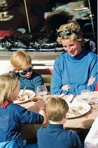 March 24, 1994: Princess Diana with Prince William, Prince Harry and unidentified companion at lunch on ski holiday in Lech, Austria.